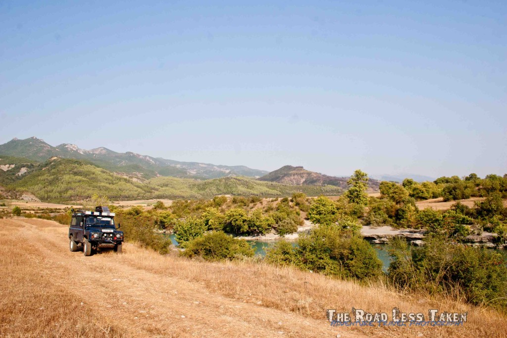 Land Rover next to Albania - Greece border river